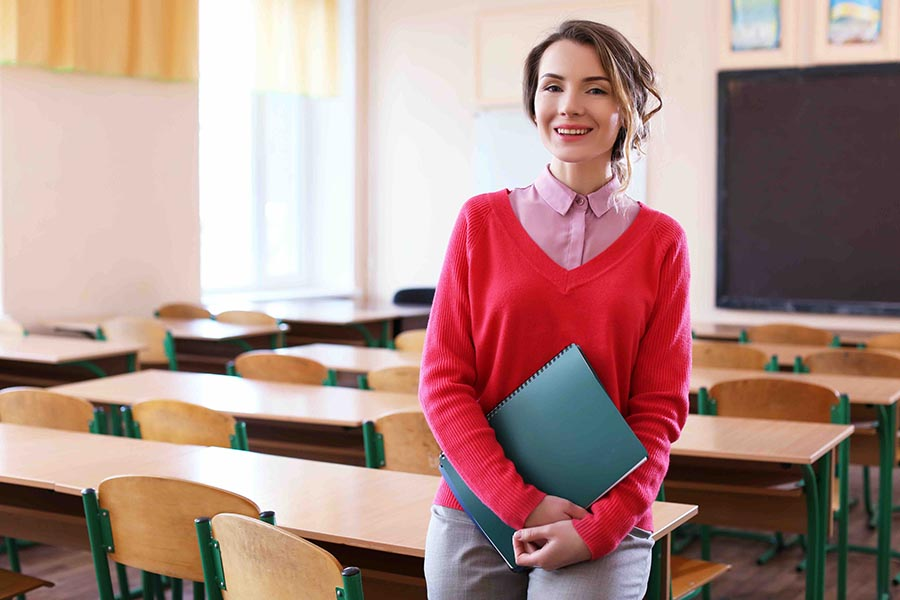 Werkgeluk: 4x zo sta je gelukkiger voor de klas